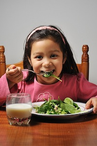 Girl eating a healthy salad